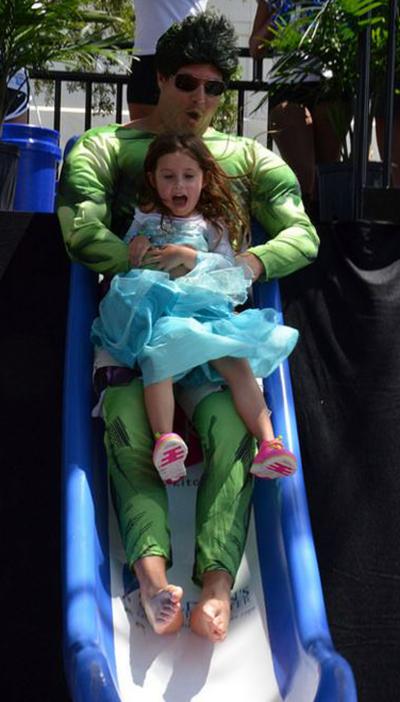 David with his daughter on a slide